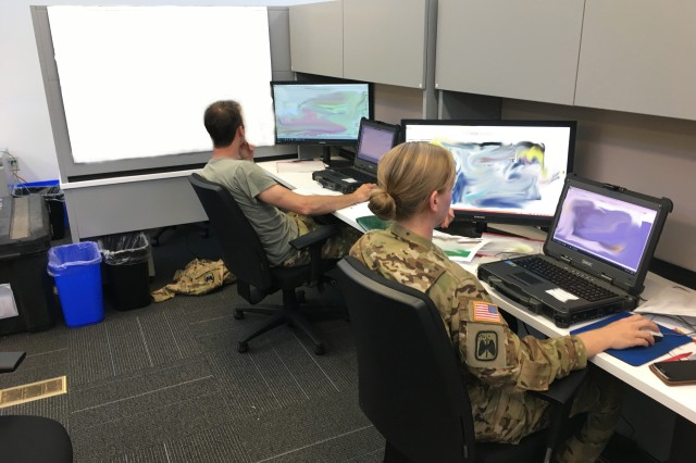 UH-60M Blackhawk pilots from Company B, 2nd Battalion, 158th Aviation Regiment plan an air assault mission using the Aviation Mission Planning System (AMPS) during record testing.