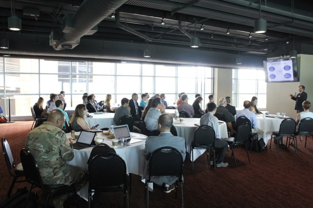 U.S. Army Research Laboratory's Dr. Rajneesh Singh delivers a technical presentation at the ARL and Uber Elevate kickoff event held Aug. 9 in Austin, Texas.