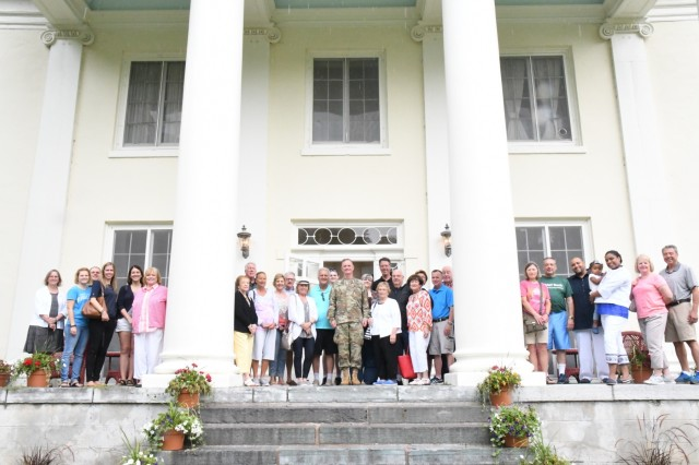 Maj. Gen. Walter E. Piatt, 10th Mountain Division (LI) and Fort Drum commanding general, stands with members of the Association of Towns of the State of New York on the steps of LeRay Mansion when they visited Fort Drum on Aug. 14 to learn more about the history of this Army installation. (U.S. Army Photo by Mike Strasser, Fort Drum Garrison Public Affairs)