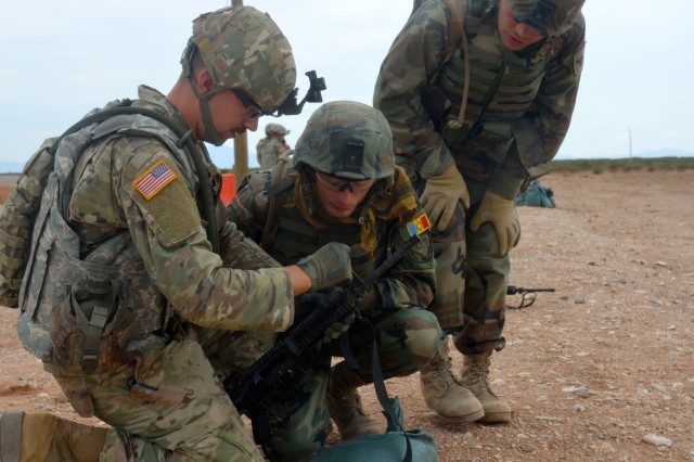 Moldovan scout snipers fire M4 carbine rifles at a range to help reinforce and sharpen their skills in basic rifle marksmanship with the assistance of Soldiers from the 30th Armored Brigade Combat Team during the 30th Armored Brigade's eXportable Combat Training Capability exercise at Fort Bliss, Texas, Aug. 8, 2018.