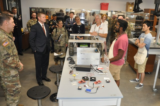 Under Secretary of the Army Ryan D. McCarthy, left, talks to Shawn Victor, an electrical and computer engineering student at the University of Texas, about the automated tank Victor designed, Aug. 8, 2018. The tour of the Cockrell Engineering School was a lead up to the U.S. Army Futures Command activation later in August.
