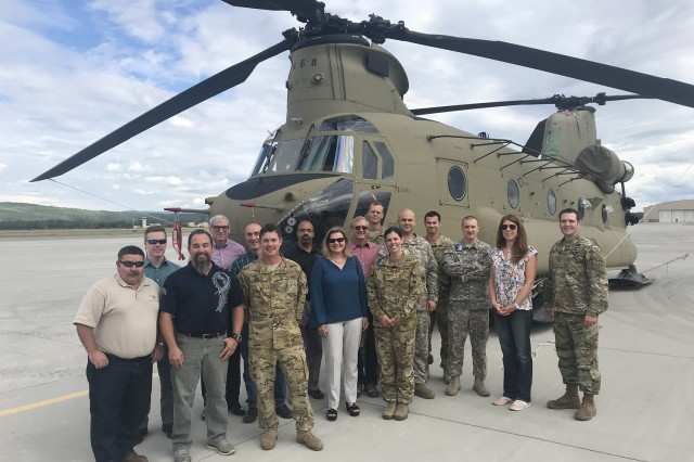 The test team and pilots from the 16th Combat Aviation Brigade's 1st Battalion, 52nd Aviation Regiment pause for a photo during the Aviation Mission Planning System test.