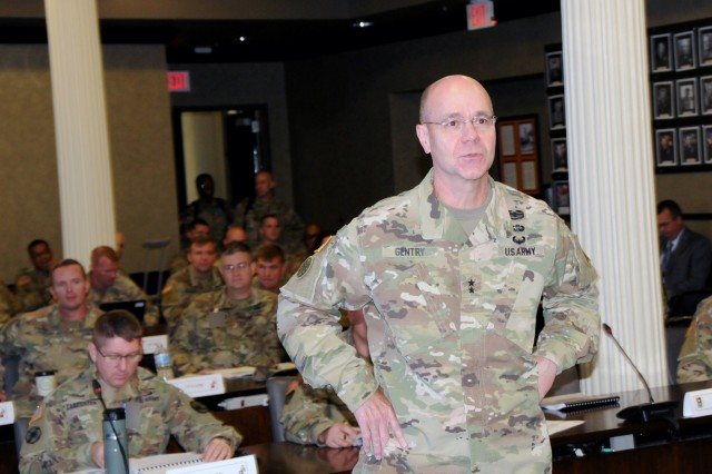 First Army Deputy Commanding General for Support, Maj. Gen. Chris Gentry, talks to attendees of the First Army Training Support and Synchronization Working Group about the importance of the conference on August 14 in the Pershing Conference Room of First Army headquarters on Rock Island Arsenal, Ill.