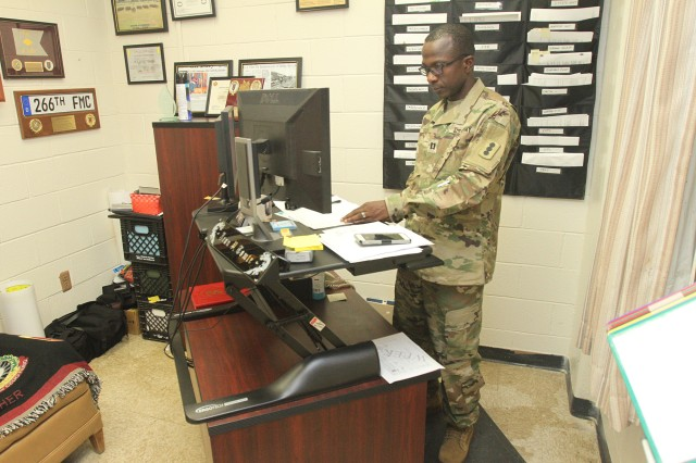 Capt. Jean Tomte, D Battery, 1st Battalion, 79th Field Artillery commander, stands and works in his office at Fort Sill, Okla. After dabbling in American fast food for about 15 years, he adopted a plant based diet four years ago and shed nearly 50 pounds.