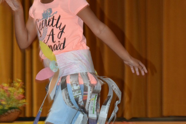 Youth from Fort Jackson school-age centers model recycled outfits and show off their skills in the post's first-ever 'recyclable fashion' and talent show Aug. 10. Singers, dancers, cheerleaders and models graced the stage in the two-hour-long show that may become a tradition.