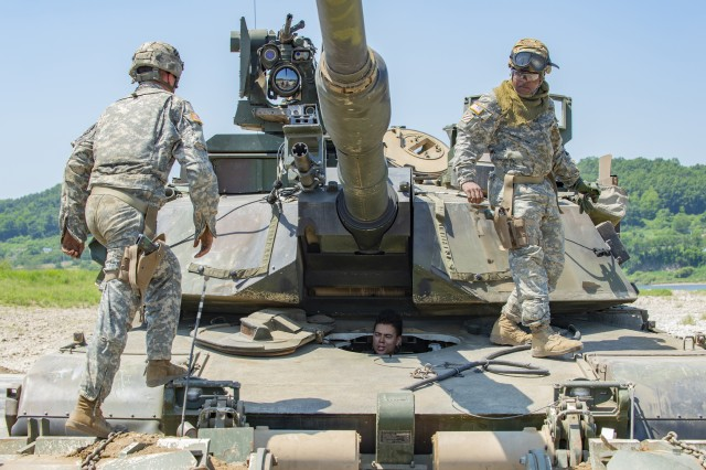 An M1 Abrams tank crew from 3rd Infantry Division's 1st Armored Brigade Combat Team conclude an exercise at the Dagmar North Training Area, South Korea, June 1, 2018.