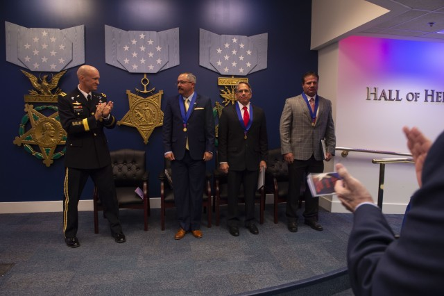 Army Lt. Gen. Darsie Rogers, left, Defense Threat Reduction Agency deputy director for combat support, applauds after awarding the Medal of Valor to Michael Anthony Dunne, William Timothy Nix and Brandon Ray Seabolt at the Pentagon, Aug. 14, 2018. The men, who are all retired Soldiers, were recognized for their actions against an armed enemy while serving as civilian contractors in Afghanistan.