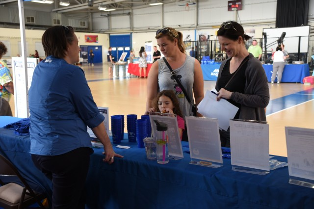 "Kelly Sarles (left), Family and MWR Support Services Division chief, speaks to Jennifer Nieves (center) and Karina Heise (right) during the  Benelux Welcome Expo Aug. 11, 2018, on Chièvres Air Base, Belgium. The welcome event was a ""one-stop"" shop for community members to get information on services available within the garrison and SHAPE."