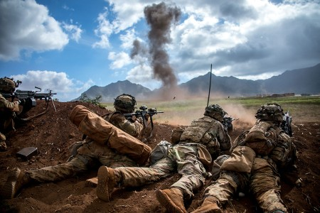 U.S. Army Soldiers assigned to 2nd Infantry Brigade Combat Team, 25th Infantry Division, provide fire suppression after the breach at a local support-by-fire position at Schofield Barracks, Hawaii, Aug. 3, 2018. The exercise is part of an overall training progression in order to maintain combat readiness in preparation for a Joint Readiness Training Center rotation later this year.