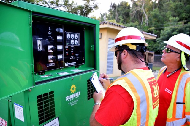 U.S. Army Corps of Engineers Quality Assurance Specialists Michael Caldwell with the Temporary Emergency Power Planning and Response Teams inspect generators that are installed across the island to ensure they continue to operate properly and provide critical facilities the power they need to operate, August 11, 2018.FEMA assigned USACE the Temporary Emergency Power Planning and Response mission to assist with assessments, maintenance, and generator installations at critical facilities, including, but not limited to: hospitals, wastewater treatment plants, water purification facilities, fire, and police stations. USACE has received $676 million to date for this mission.