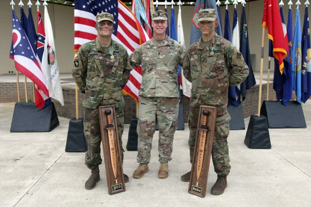 Maneuver Support Center of Excellence and Fort Leonard Wood Command Sgt. Maj. Jon Stanley poses with the 2018 TRADOC Best Warrior Competition NCO and Soldier of the Year winners, Staff Sgt. Joseph Hansen and Pfc. David Cox. These two Fort Leonard Wood Soldiers will now advance to the U.S. Army Best Warrior Competition at the end of September.