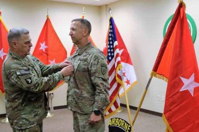U.S. Army Chief of Staff, Gen. Mark A. Milley, places one-star rank on newly-promoted Brig. Gen. Scott A. Jackson during a promotion ceremony in the United States Forces -- Afghanistan headquarters on Bagram Airbase, Afghanistan, August 14. (U.S. Army photo by Maj. Matt Fontaine)