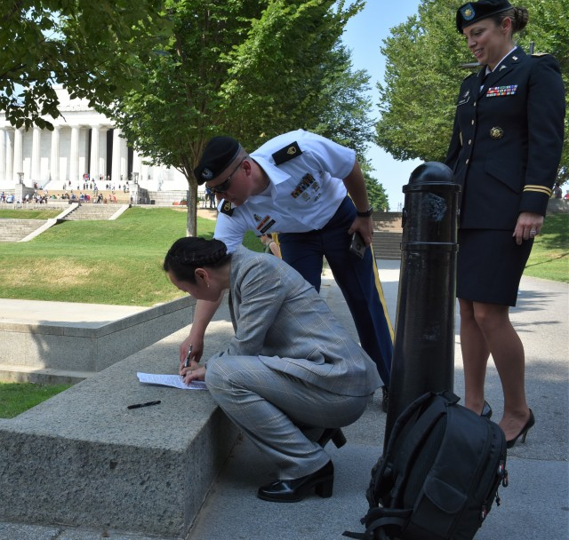 Army's Newest Doctor Signs In on the Mall