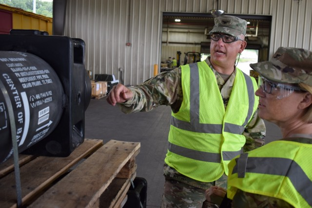 Col. Michael Garlington, commander of Crane Army Ammunition Activity, discusses Crane Army's capabilities with Col. Michelle Letcher, commander of Joint Munitions Command during her tour of CAAA to learn more about how Crane Army delivers lethality to the Warfighter. Crane Army specializes in conventional munitions support for U.S. Army and Joint Force readiness, including storage, quality control, shipment preparation, distribution, production and demilitarization.