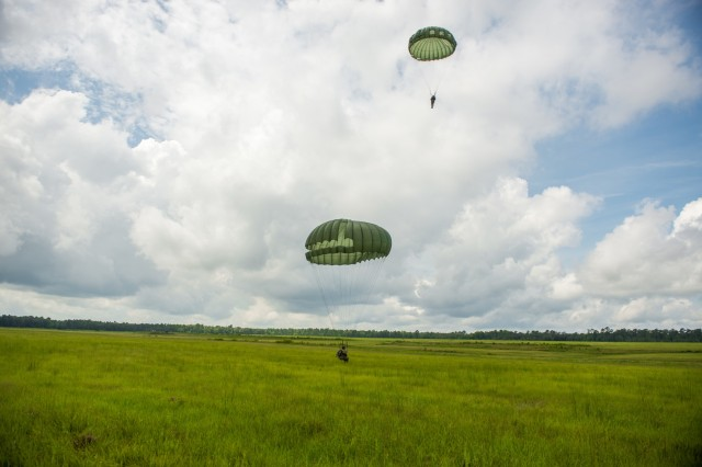 """Soldiers of the 1st Battalion, 507th Parachute Infantry Regiment at Fort Benning, Georgia, the Liberty Jump Team and Veterans Association, honor the first jump of the test platoon on National Airborne Day, August 16, 2018 at Fort Benning, Georgia.  National Airborne Day commemorates the first jump conducted by the Airborne Test Platoon onto Cactus DZ on 16 August 1940 and pays homage to the brave men who tested the Airborne concept. The Liberty Jump Team, supported by the 1-507th executed an Airborne Operation onto Fryar DZ, out of the storied C-47 """"Skytrain"""" to honor our proud history and storied tradition.  (Photos by Patrick A. Albright, MCoE PAO Photographer)"""