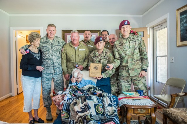Soldiers from the 1st Battalion, 507th Parachute Infantry Regiment and members of the Liberty Jump Team visit Maj. (Ret.) Lubert Wing at his home, August 15, 2018 in Phenix City, Alabama.  Wing, 93, and a veteran of World War II, Korea, and Vietnam fought in the Ardennes during the Battle of the Bulge and later jumped into Operation Varsity.  He commissioned in 1952 and retired from active duty as a Major in 1965.  Maj. (Ret.) Wing was a helicopter pilot instructor until the age of 75. (U.S. Army photo by Patrick Albright, Maneuver Center of Excellence, Fort Benning Public Affairs)