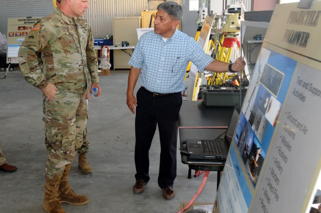 "Acting Engineering Support Branch Chief Ruben Hernandez (right) briefs Maj. Gen. Joel Tyler, Army Test and Evaluation Command Commanding General, about U.S. Army Yuma Proving Ground's geodetic capabilities during a recent visit. Hernandez has worked at YPG for over 35 years, and his been familiar with the post since childhood when his father worked here. ""I knew this was where I wanted to work, mostly through my dad. I was always intrigued when he talked about work."""