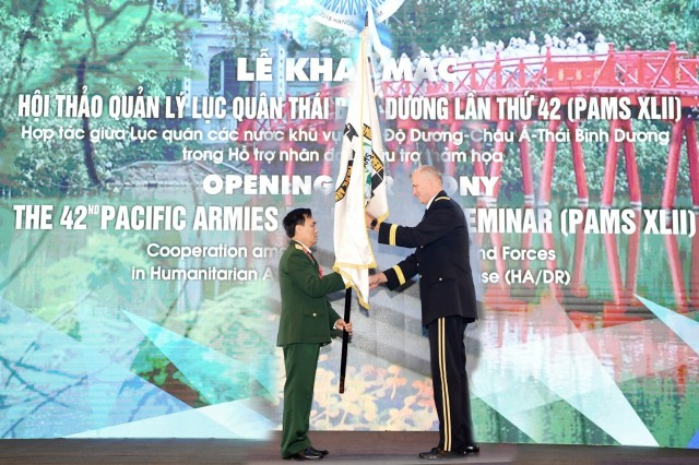 HANOI, Vietnam-Gen. Robert B. Brown, commander, U.S. Army Pacific Sr. Lt. Gen. Pham Hong Huong, Vietnamese Deputy Chief of General Staff (left) and Gen. Robert B. Brown, commander, U.S. Army Pacific pass the Pacific Armies Management Seminar flag during the opening ceremony for the 42nd PAMS and 4th Senior Enlisted Leader Forum, 20 Aug. 2018, Hanoi, Vietnam. USARPAC, headquartered in Honolulu, Hawaii, and another Indo-Pacific country have co-hosted the event annually since 1977. The seminar is a forum for senior-level land force officers to meet and discuss professional military subjects on a non-attribution basis. It has proven its value by enhancing mutually beneficial army-to-army associations, furthering the long-term objectives of promoting peace and stability in the Indo-Pacific region through understanding, dialogue, and interpersonal relationships. (Courtesy photo: Vietnam People's Army Newspaper)