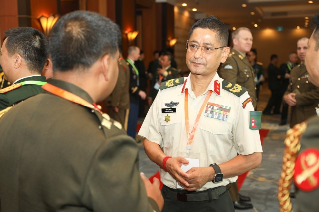 HANOI, Vietnam-Senior military leaders mingle prior to the opening ceremony for the 42nd Pacific Armies Management Seminar and 4th Senior Enlisted Leader Forum, 20 Aug. 2018, Hanoi, Vietnam. USARPAC, headquartered in Honolulu, Hawaii, and another Indo-Pacific country have co-hosted the event annually since 1977. The seminar is a forum for senior-level land force officers to meet and discuss professional military subjects on a non-attribution basis. It has proven its value by enhancing mutually beneficial army-to-army associations, furthering the long-term objectives of promoting peace and stability in the Indo-Pacific region through understanding, dialogue, and interpersonal relationships. (U.S. Army photo by Russell Shimooka)