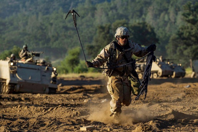 U.S. Army Reserve combat engineer Soldiers with the 350th Engineer Company breach through enemy territory to gain ground during a combined arms breach at Combat Support Training Exercise at Fort Hunter Liggett, Calif., July 22, 2018.