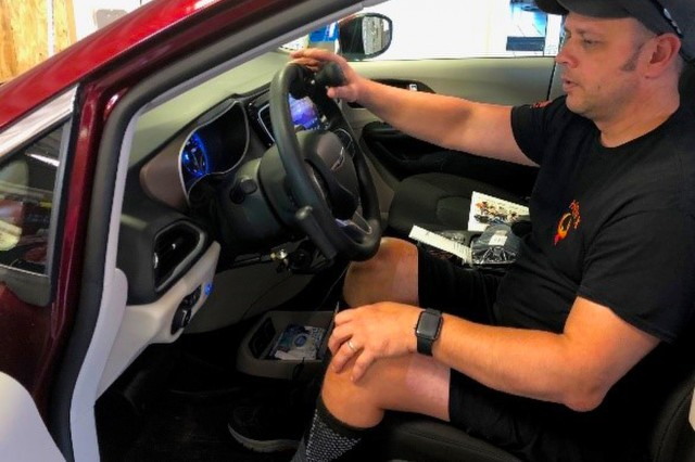 Chief Warrant Officer 4 Stephen Schroeder checks out the new hand controls that were installed in his vehicle. ((Photo Courtesy, Fort Campbell Warrior Transition Unit)