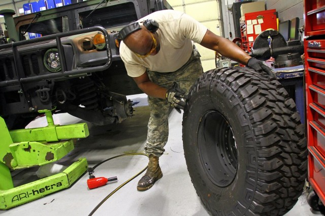 Sgt. Rudon Gay inspects a tire prior to installation on a Humvee at Field maintenance Shop #5 in Frankfort, Ky., Aug 17, 2018. More than 1,200 tires were considered damaged and replaced on Kentucky Guard vehicles after a defect was discovered.