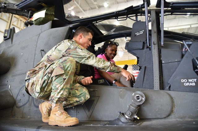Destinee Croom, an item manager for Black Hawk helicopters, speaks with Maj. Matthew Brown about Apache aircraft components. (Photo by Preston Benson, RTC)