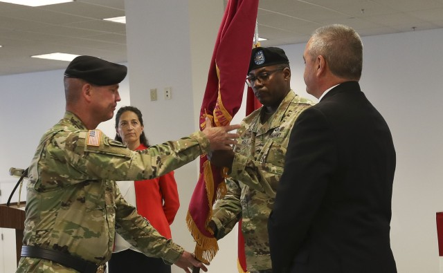 Col. Milton G. Kelly receives the Watervliet Arsenal colors