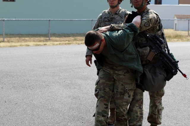 Soldiers from 170th Military Police Company, 504th Military Police Battalion, 42nd Military Police Brigade escorts a wounded detainee to a Detainee Holding Area during training on Joint Base Lewis-McChord, Wash. August 13, 2018