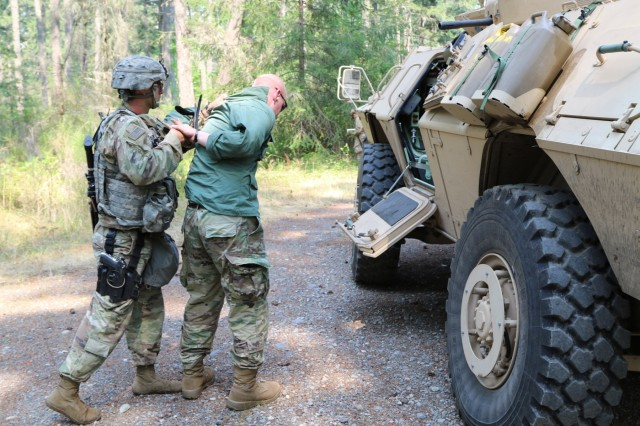 SPC Taylor Morris from 170th Military Police Company, 504th Military Police Battalion, 42nd MP BDE conducts detainee operations training during 42nd MP BDE's third quarter FTX on Joint Base Lewis-McChord, Wash. August 13, 2018