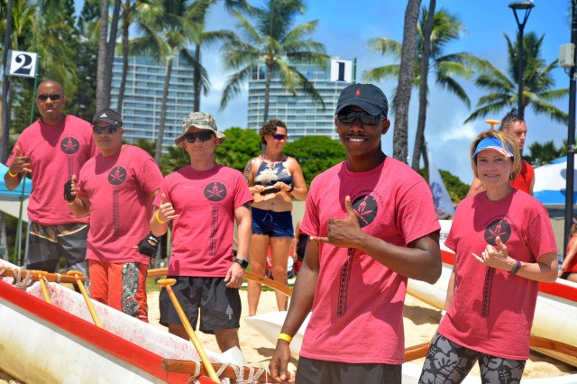 Tripler Army Medical Center leaders and command staff get ready to compete at the 9th annual Na Koa Wounded Warrior Canoe Regatta to honor and support wounded warriors, their families, and the families of our nation's fallen heroes at Fort DeRussy in Waikiki, Hawaii, Aug. 18.