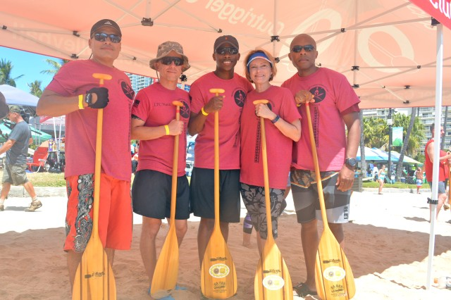 """The """"TAMC Spartans"""" outrigger canoe paddling team gets ready to compete at the 9th annual Na Koa Wounded Warrior Canoe Regatta to honor and support wounded warriors, their families, and the families of our nation's fallen heroes at Fort DeRussy in Waikiki, Hawaii, Aug. 18."""