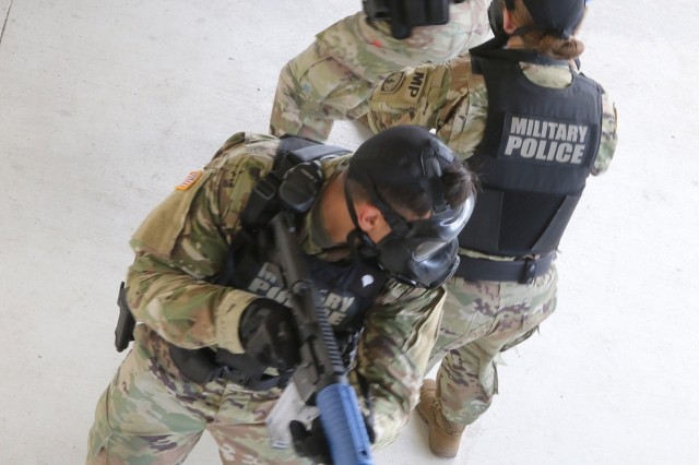Military police officers with 293rd Military Police Company, 385th Military Police Battalion, 16th Military Police Brigade, conduct active shooter response training at Fort Stewart, Ga., Aug.17, 2018. The training ensures MPs are prepared to react to any active shooter scenario. (U.S. Army photo by Spc. Jason Greaves, 50th Public Affairs Detachment, 3rd Infantry Division public affairs)