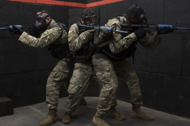 Military police officers with the 293rd Military Police Company, 385th Military Police Battalion, 16th Military Police Brigade, conduct active shooter response training at Fort Stewart, Ga., Aug.17, 2018. The training ensures MPs are prepared to react to any active shooter scenario. (U.S. Army photo by Spc. Jason Greaves/ released)