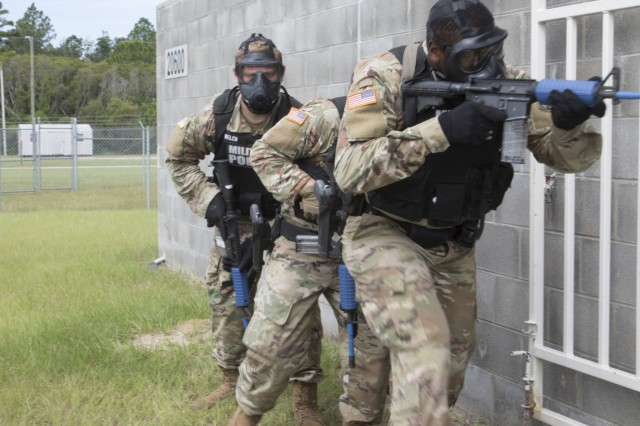 Military police officers with the 293rd Military Police Company, 385th Military Police Battalion, 16th Military Police Brigade, conduct active shooter response training at Fort Stewart, Ga., Aug.17, 2018. The training ensures MPs are prepared to react to any active shooter scenario. (U.S. Army photo by Jason Greaves/ released)