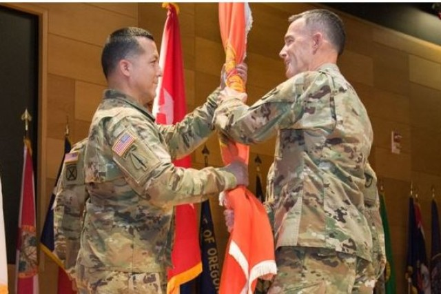 Command Sgt. Maj. Frank Gutierrez, left, assumes responsibility as the senior enlisted advisor to Maj. Gen. Randy Taylor, right, the APG Senior Commander and commanding general of U.S. Army Communications-Electronics Command, during a Change of Responsibility ceremony at the Meyer Auditorium Aug. 9, 2018. |