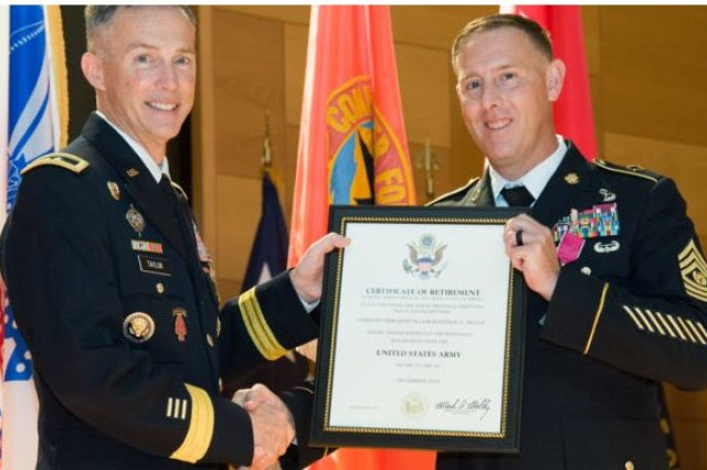 CECOM Commanding General and APG Senior Commander Maj. Gen. Randy Taylor presents the Certificate of Retirement, signed by the Chief of Staff of the U.S. Army Gen. Mark Milley, to outgoing CECOM Command Sgt. Maj. Matthew McCoy during a retirement ceremony at the Myer Auditorium Aug. 9, 2018.