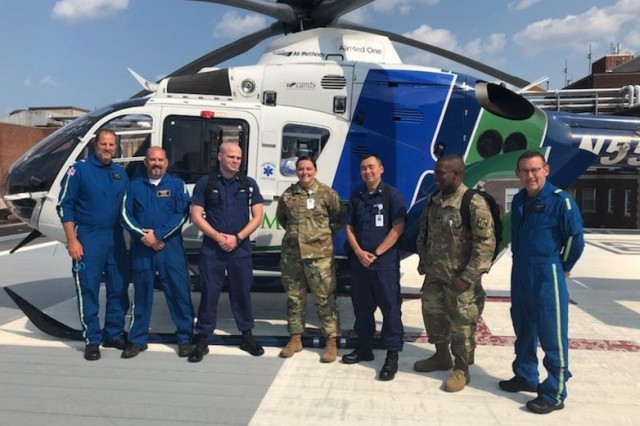 Service members and Hackensack University Hospital air ambulance staff pose for a photo during Strategic Medical Asset Readiness Training (SMART), Aug. 16, 2018. The SMART partnership in Hackensack, N.J., is a first-of-its-kind partnership which focuses on high-quality, individualized specialty medical training for service members to improve their knowledge, skillsets and increase soldier readiness. (U.S. Army photo courtesy Brig. Gen. Carl Reese)