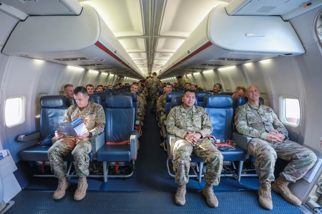 Soldiers assigned to the 3rd Squadron, 2nd Cavalry Regiment prepare for departure aboard an aircraft at the Nuremberg Airport, Germany, July 26, 2018. The Department of Defense announced in August 2018 a contract award aimed at overhauling the Defense Travel System.