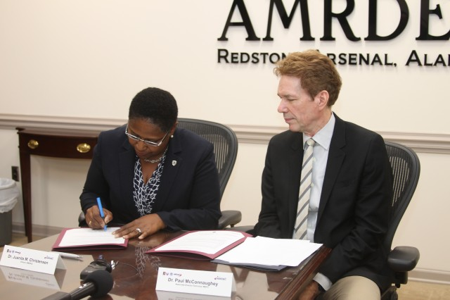 AMRDEC Director Dr. Juanita Christensen and MSFC Associate Director Dr. Paul McConnaughey signed an Integrated Product Team Charter Aug. 20, which will provide a means for sharing additive manufacturing knowledge and resources across Redstone Arsenal.