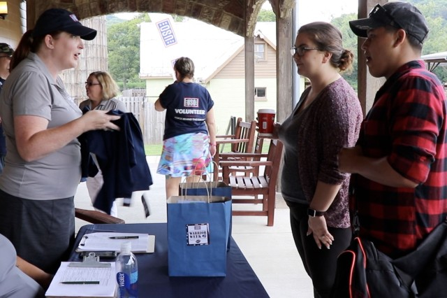 An Army family checks-in at USO Warrior Week Nashville, Tennessee, Aug. 17. The Nashville event is one of three Warrior Weeks being held by the USO nationwide. The events focus on outdoor activities, music therapy, and honoring service members and their families.