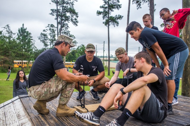 FORT BENNING, Ga. (Aug. 21, 2018) -- Students from the Chattahoochee County High School Junior Reserve Officer Training Corps program in Cusseta, Georgia, complete a team development course and use the Engagement Skills Trainer at Wood Simulation Center at Fort Benning, Georgia, Aug. 21. The Airborne and Ranger Training Brigade hosted the students on post as a part of the Partners in Education initiative. (U.S. Army photo by Patrick A. Albright, Maneuver Center of Excellence, Fort Benning Public Affairs)