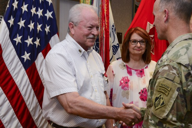James C. Melton accompanied by his wife Joanne Melton shakes hand with Maj. Gen. Michael C. Wehr, U.S. Army Corps of Engineers deputy commanding general, following the pinning of the Bronze Star medal. Melton was formally presented with the Bronze Star Medal he earned for his actions in Vietnam in 1969 during a ceremony at the U.S. Army Corps of Engineers Headquarters in Washington, D.C., August 15, 2018. (Photo by Jarrell Dillard, U.S. Army Corps of Engineers)
