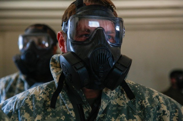 JOINT BASE LEWIS-MCCHORD, Washington - A Soldier with the 1st Special Forces Group (Airborne) waits for instructions to remove his mask inside a CS gas chamber August 24, during a chemical, biological, radiological and nuclear defense confidence course. This exercise is designed to validate Soldiers' skills and confidence with their protective equipment so that they are trained and ready to respond to our nation's most complex and immediate problems. (U.S. Army photo by Sgt. Ian Ives, 1st Special Forces Group (Airborne) /Released).