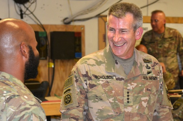 Army Gen. John W. Nicholson, commander of NATO's Resolute Support mission and U.S. forces in Afghanistan, visits with service members at Train, Advise and Assist Command East in Afghanistan's Lagham province, Aug. 9, 2018.