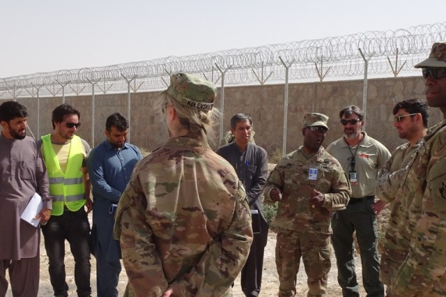 Afghanistan District Commander, Col. Jason Kelly and Command Sergeant Major Nathaniel Atkinson talk with Special Mission Wing Commander about the Afghan Technical Support Team and their mission. The Chief of Engineering and Technical Services Division and Personal Services Contract COR were also on site.