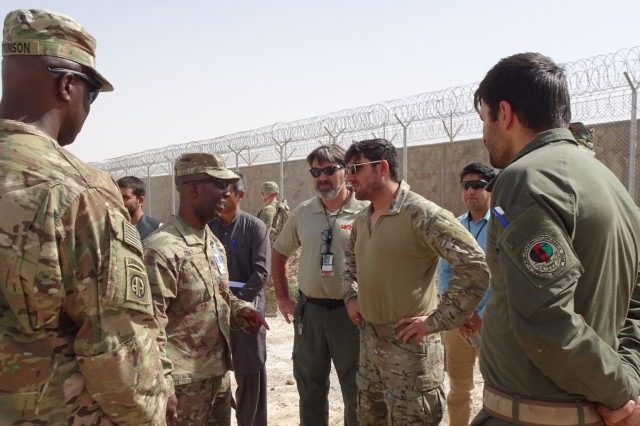 Afghanistan District Commander, Col. Jason Kelly and Command Sergeant Major Nathaniel Atkinson greet the Special Mission Wing Commander at the Special Mission Wing site on August 19 in Kandahar, Afghanistan.