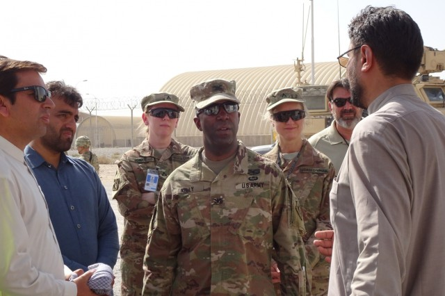 Afghanistan Technical Support Team member briefs Col. Jason Kelly, Afghanistan District Commander on the Special Mission Wing Power Plant assessment. Chief of Engineering and Technical Services Division and the Personal Services Contract COR were also on site.