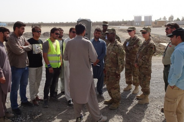 Afghanistan Technical Support Team members briefing the Afghanistan District Commander, Col. Jason Kelly, along with Command Sergeant Major Nathaniel Atkinson on the Special Mission Wing Power Plant assessment and their overall mission.