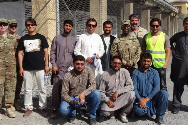 Members of the Afghan Technical Support Team and Afghanistan District leadership, Col. Jason Kelly and Command Sergeant Major Nathaniel Atkinson partner up for a group photo during a recent site visit to Kandahar, Afghanistan.